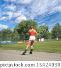 Pretty girl goes on roller skates 15424939
