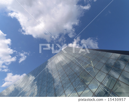 Glass pyramid and blue sky and clouds 15430957