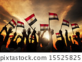 Silhouettes of People Holding the Flag of India 15525825