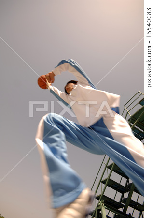 Young youth playing basketball 15540083
