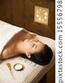 Beautiful Asian Woman in Spa Salon Getting Massage 15556798