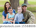 Handsome soldier reunited with family 15568606
