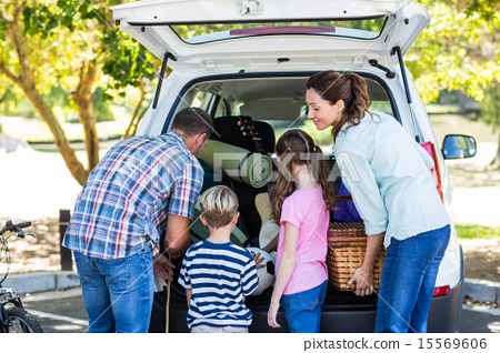 Stock Photo: Happy family getting ready for road trip