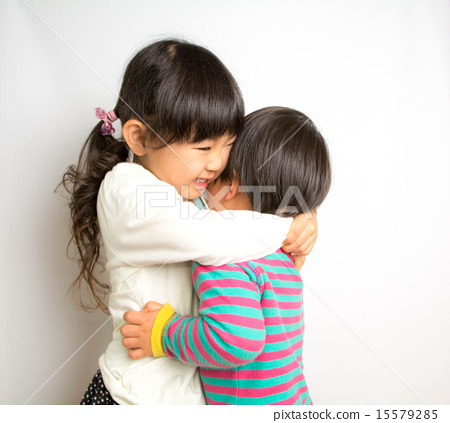 My sister hugs his brother 15579285