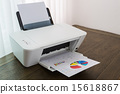 Printer with financial documents on a wood table 15618867