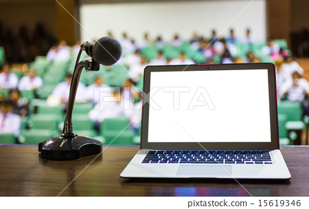 Laptop and microphone on the rostrum  15619346