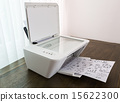 Printer with financial documents on a wood table 15622300