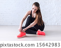 Sportive active girl lacing trainers sports shoes tie shoelaces  15642983
