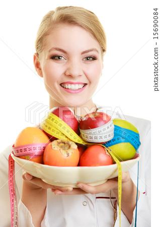 Doctor dietitian recommending healthy food. Diet. 15690084