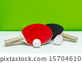 ping-pong rackets and white balls isolated 15704610
