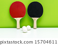 ping-pong rackets and white balls isolated 15704611