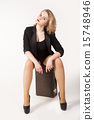 Sexy blonde woman on old suitcase 15748946