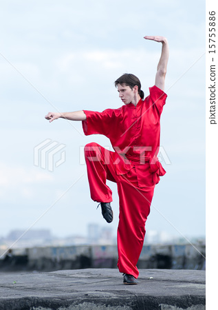 Stock Photo: Wushoo man in red practice martial art