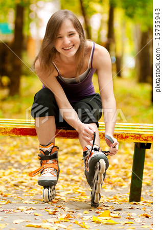 Woman on roller skates in the park 15755943