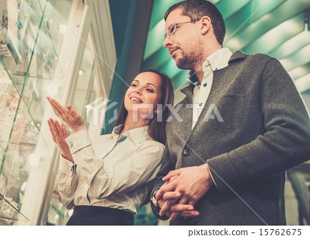 Stock Photo: Man with assistant help choosing jewellery
