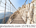 Broad view of a suspension bridge across a river in Shaolin 15781282