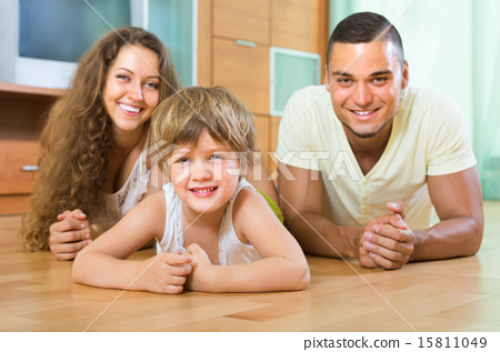 Happy couple with child at home 15811049