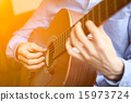 acoustic playing guitar 15973724