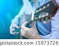 acoustic playing guitar 15973726
