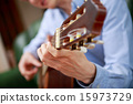 acoustic playing guitar 15973729