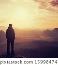 Silhouette of young tourist with hands in pockets 15998474