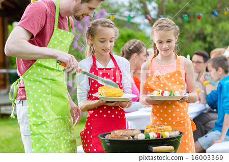 Family having barbeque at garden party 16003369