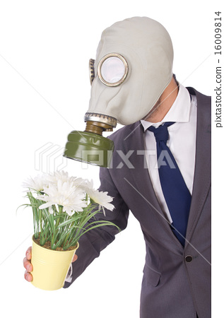Businessman wearing gas mask isolated on white 16009814