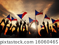 Silhouettes of People Holding the Flag of Philippines 16060465