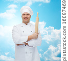 happy male chef cook holding rolling pin 16097469