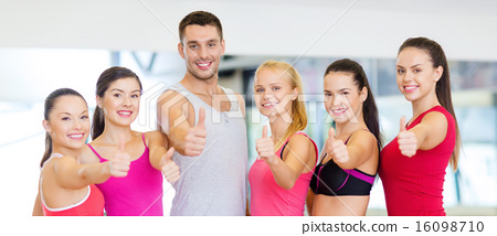 Stock Photo: group of people in the gym showing thumbs up