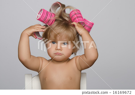 Little attractive kid with hair curlers 16169672