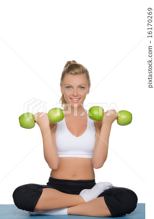 Young woman with dumbbells of green apples 16170269