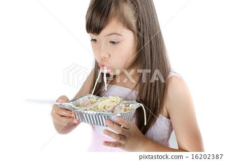 Little girl eating spaghetti 16202387