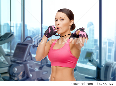 Stock Photo: asian woman coach blowing whistle over gym