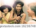 asian young woman singing a song in caraoke en 16236748