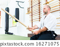 Man at Aikido martial arts with wooden sword 16271075