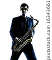 man saxophonist playing saxophone player  silhouette 16343661