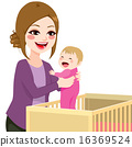 Mom Picking Baby From Crib 16369524