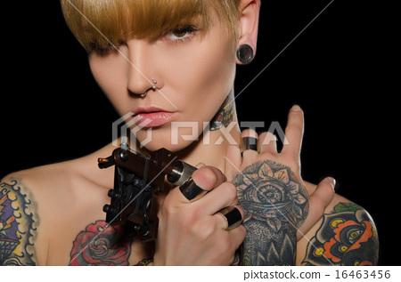 tattooed charming woman with tattoo machine 16463456