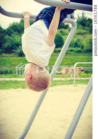Active child kid having fun in playground. 16501788