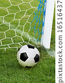 soccer ball in goal net 16516437
