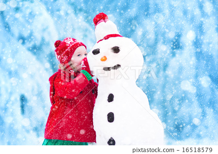 Stock Photo: Funny little toddler girl playing with a snow