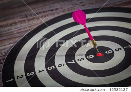 Dartboard on wood wall (Darts Hit Target) 16526127