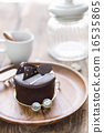 Dark chocolate cake on wooden background 16535865