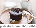 Dark chocolate cake on wooden background 16535866