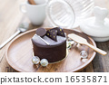 Dark chocolate cake on wooden background 16535871