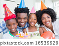 Happy family celebrating a birthday together 16539929