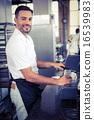 happy worker making coffee 16539983