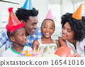 Happy family celebrating a birthday together 16541016