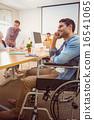 Creative businessman in wheelchair on the phone 16541065